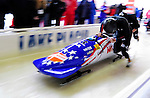 18 December 2010: John Napier pushes his 2-man bobsled for the USA, finishing in 7th place at the Viessmann FIBT World Cup Bobsled Championships on Mount Van Hoevenberg in Lake Placid, New York, USA. Mandatory Credit: Ed Wolfstein Photo