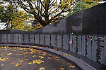 Washington State Vietnam Veterans Memorial with names of the dead engraved in marble with American flags, Fall colors, State capital, Olympia, Washington USA