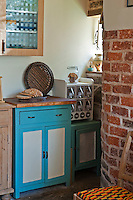 Four small mis-matched cupboards make a refreshing change from the usual fitted kitchen