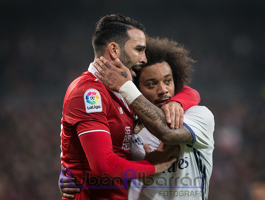 Real Madrid´s Brazilian defense Marcelo and Sevilla´s Rami during the Copa del Rey soccer match between Real Madrid and Sevilla played at the Santiago Bernabéu stadium in Madrid, on January 4th 2017.