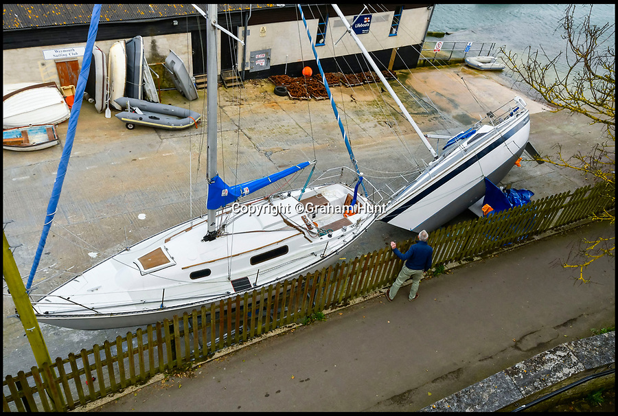 BNPS.co.uk (01202 558833)<br /> Pic: Graham Hunt/BNPS.<br /> <br /> A yachtsman has been crushed to death by his own boat which fell on him while he worked on it at a yacht club.<br /> <br /> The 56-year-old man was carrying out general repairs beneath the 29ft sailing yacht when it suddenly toppled over on to him.<br /> <br /> He was found under the half-a-ton wooden vessel and although ambulance paramedics tried to save him, he was pronounced dead at the Weymouth Sailing Club in Dorset.<br /> <br /> Members there said the victim, thought to be a company director, had joined the club a year ago after moving to the area.