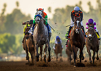 ARCADIA, CA - DECEMBER 26: Unique Bella # 3 with Mike Smith up holds of Paradise Woods #7 and Flavien Prat to win the La Brea Stakes at Santa Anita Park on December 26, 2017 in Arcadia, California. (Photo by Alex Evers/Eclipse Sportswire/Getty Images)