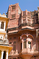 Jodhpur at Fort Mehrangarh in Rajasthan India man in window of Fort Palace in costume