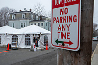 A medical worker wearing a protective hood awaits patients for COVID-19 drive-through testing at the testing tent in a parking lot near the Cambridge Health Alliance Women's Health Hospital in Somerville, Massachusetts, on Mon., March 23, 2020. Patients could make appointments to drive through the parking lot to get tested for the virus during the ongoing Coronavirus (COVID-19) global pandemic. This location is one of a handful of such testing facilities that have opened in the Boston area in the past week.