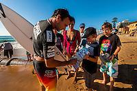 Joel Parkinson, pro surfer signing autographs, Australian Open of Surfing, Manly Beach, Sydney, New South Wales, Australia