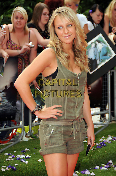 "CHLOE MADELEY .UK Gala Premiere of ""The Twilight Saga: Eclipse"" at the Odeon Leicester Square, London, England, UK, July 1st 2010..half  length green khaki playsuit sleeveless hand on hip romper black bra showing .CAP/CAS.©Bob Cass/Capital Pictures."