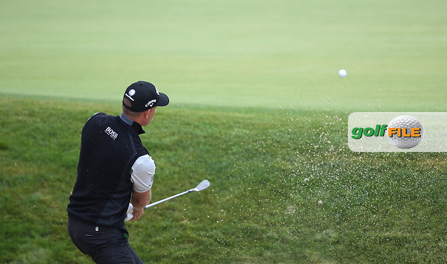 Henrik Stenson (SWE) plays out of the bunker but the shot goes long during the 5th play-off hole of the Final Round of the BMW International Open 2014 from Golf Club Gut Lärchenhof, Pulheim, Köln, Germany. Picture:  David Lloyd / www.golffile.ie