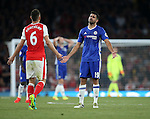 Chelsea's Diego Costa argues with Arsenal's Laurent Koscielny after he gets booked during the Premier League match at the Emirates Stadium, London. Picture date September 24th, 2016 Pic David Klein/Sportimage