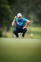 Lucas Bjerregaard of Denmark in act at the third round of the Hong Kong Open golf tournament in Fanling Golf Club, Hong Kong,  24 Oct., 2015