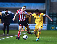 Lincoln City's Harry Anderson vies for possession with Northampton Town's David Buchanan<br /> <br /> Photographer Andrew Vaughan/CameraSport<br /> <br /> Emirates FA Cup First Round - Lincoln City v Northampton Town - Saturday 10th November 2018 - Sincil Bank - Lincoln<br />  <br /> World Copyright &copy; 2018 CameraSport. All rights reserved. 43 Linden Ave. Countesthorpe. Leicester. England. LE8 5PG - Tel: +44 (0) 116 277 4147 - admin@camerasport.com - www.camerasport.com