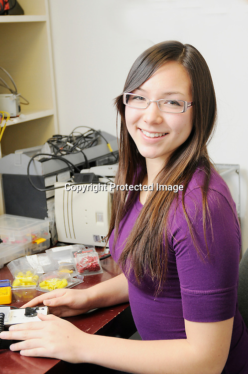 Stock photo teenager working on electronics