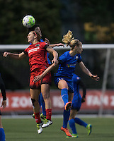 Seattle, WA - Saturday, May 14, 2016: Portland Thorns FC midfielder Lindsey Horan (7) goes up for a head against Seattle Reign FC midfielders Keelin Winters (11), center and Beverly Yanez (17) during the second half. The Portland Thorns FC and the Seattle Reign FC played to a 1-1 tie during a regular season National Women's Soccer League (NWSL) match at Memorial Stadium.
