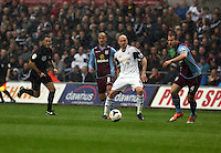 Sunday, 26 April 2014<br /> Pictured: Jonjo Shelvey of Swansea (C) attempts to cross the ball with a header overRon Vlaar of Aston Villa (R)<br /> Re: Barclay's Premier League, Swansea City FC v Aston Villa at the Liberty Stadium, south Wales.