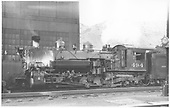 Fireman side view of K-37 #494 at Salida with engine shop in background.<br /> D&amp;RGW