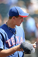 Derek Holland - Texas Rangers, signs an autograph before a spring training game against the Kansas City Royals at Surprise Stadium, 03/06/2010..Photo by:  Bill Mitchell/Four Seam Images.