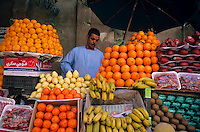 Market vendor selling fruit in a bazaar, Aswan, Egypt.