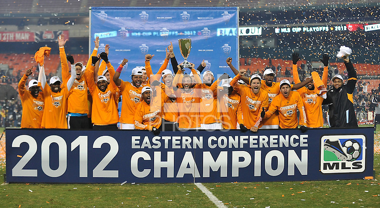 Houston Dynamo captain Brad Davis lifts the Eastern Conference Trophy and celebrates with teammates. D.C. United tied The Houston Dynamo 1-1 but lost in the overall score 4-2 in the second leg of the Eastern Conference Championship at RFK Stadium, Sunday November 18, 2012.