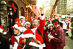 NEW YORK, NY - DECEMBER 15: Revelers dressed as Santa Claus wait in lines to get into bars on 3rd avenue during the annual SantaCon event December 15, 2012 in New York City. (Photo by Donald Bowers)