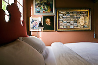 The master bedroom overlooking the moat is painted a deep coral pink