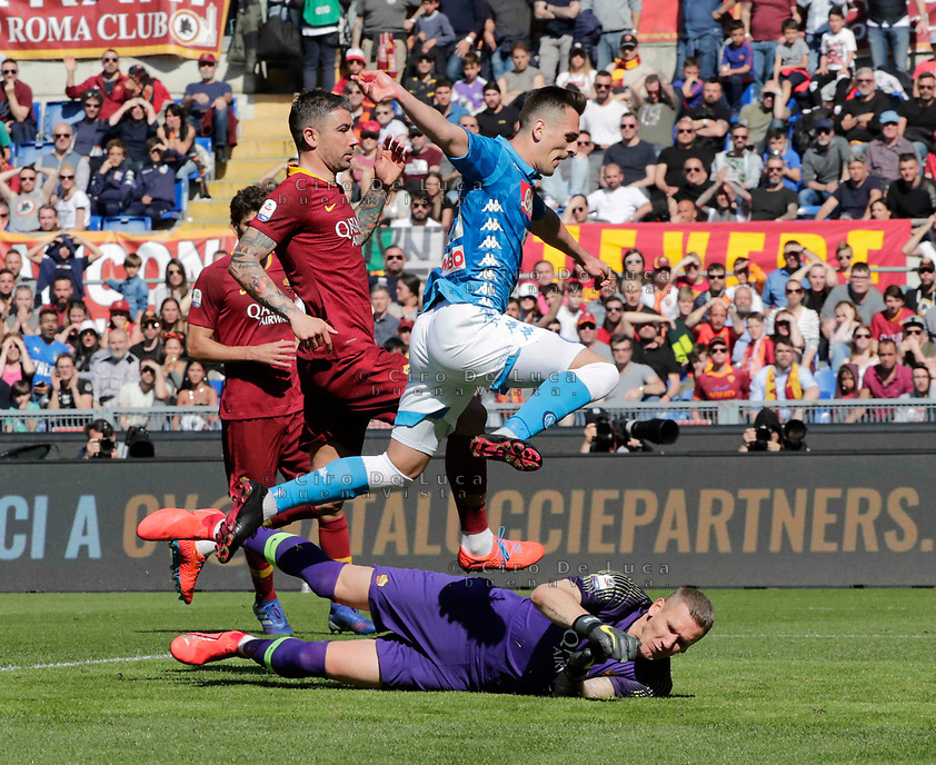 Arkadiusz Milik of Napoli  and Patrick Olsen of AS Roma  during the  italian serie a soccer match, AS Roma -  SSC Napoli       at  the Stadio Olimpico in Rome  Italy , March 31, 2019