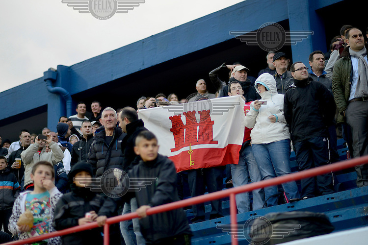 Fans unfurl a Gibraltar flag in the stands of the Victoria Stadium during an under-17 football match against Northern Ireland. Although the United Nations doesn't recognise Gibraltar as an independent country, UEFA has recognised it and has granted the British Overseas Territory full UEFA membership.