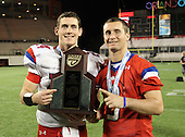Manatee Hurricanes quarterback Cord Sandberg #24 and brother, wide receiver Chase Sandberg #9 who did not play due to injury, pose with the Championship trophy after the Florida High School Athletic Association 7A Championship Game at Florida's Citrus Bowl on December 16, 2011 in Orlando, Florida.  Manatee defeated First Coast 40-0.  (Photo By Mike Janes Photography)