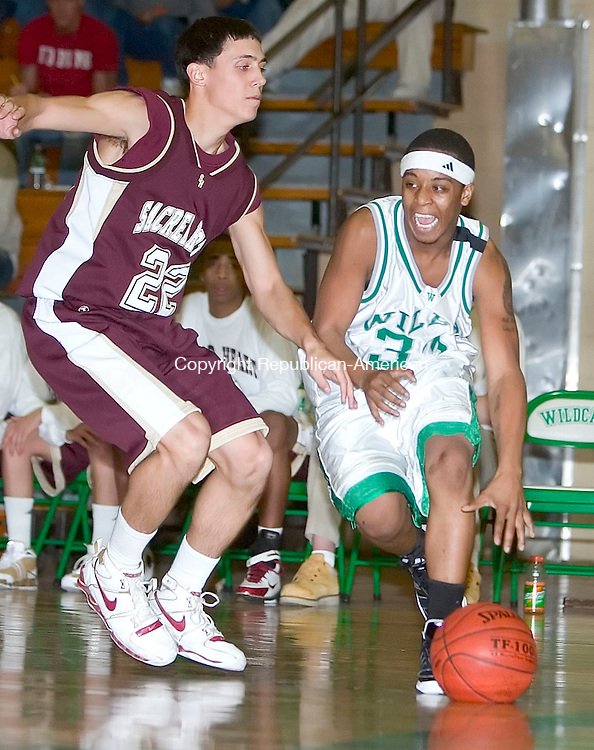 WATERBURY, CT- 15 DEC 06- 121506JT15- <br /> Wilby's Paul Jefferson dribbles past Sacred Heart's Bobby George at Friday's game at Wilby. Sacred Heart won 68-65.<br /> Josalee Thrift Republican-American