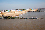 Colourful beach huts line the promenade at Southwold, Suffolk, England