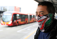 """BOGOTA, COLOMBIA - March 13:  A man wears a face mask before riding the public transportation """"Transmilenio"""" on March 13, 2020 in Bogota, Colombia. The World Health Organization declared a global pandemic as the coronavirus rapidly spreads across the world. Colombian President Ivan Duque declared a health emergency to contain an outbreak of coronavirus, suspending public events with more than 500 people. (Photo by John W. Vizcaino/VIEWpress)"""