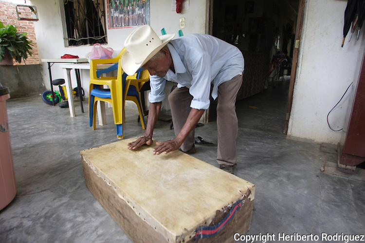 An Afro-Mexican prepares an artesa, a type of box used for dancing the artesa dance at a San Nicolas house on the coast of Guerrero state, July 6, 2005. Afro- Mexicans are considered one of the three ethnic roots that comprise Mexico. Photo by Heriberto