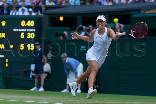 01.07.2014.  London, England.  Wimbledon Championships Day Eight  Angelique Kerber of Germany in action against Maria Sharapova of Russia during day eight ladies singles fourth round match at the Wimbledon Tennis Championships at The All England Lawn Tennis Club in London, United Kingdom