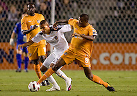 Puerto Islanders Christopher Nurse (8) steals the ball from LA Galaxy defender Leonardo De Silva (22). The Puerto Rico Islanders defeated the LA Galaxy 4-1 during CONCACAF Champions League group play at Home Depot Center stadium in Carson, California on Tuesday July 27, 2010.