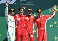 LEWIS HAMILTON (GBR) of Mercedes-AMG Petronas Motorsport, Claudio Albertini of Scuderia Ferrari, SEBASTIAN VETTEL (GER) of Scuderia Ferrari and KIMI RÄIKKÖNEN (FIN) of Scuderia Ferrari on the podium during The Formula 1 2018 Rolex British Grand Prix at Silverstone Circuit, Northampton, England on 8 July 2018. Photo by Vince  Mignott.