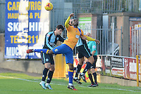 Mansfield Town's Craig Westcarr challenges for a throw-in with Wycombe Wanderers Joe Jacobson and Luke O'Nien during the Sky Bet League 2 match between Mansfield Town and Wycombe Wanderers at the One Call Stadium, Mansfield, England on 31 October 2015. Photo by Garry Griffiths.