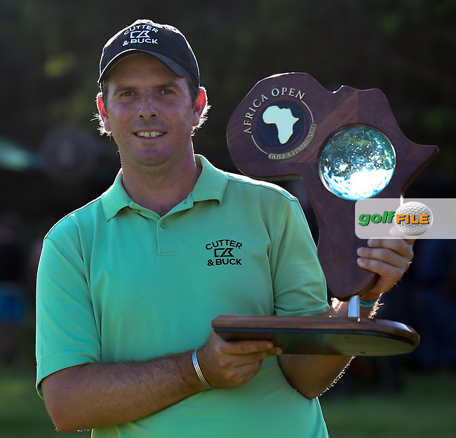 Thomas Aiken (RSA) with the 2014 winner's trophy at The Africa Open 2014 at the East London Golf Club, Eastern Cape, South Africa. Picture:  David Lloyd / www.golffile.ie