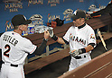 (L-R) Brett Butler, Ichiro Suzuki (Marlins),<br /> APRIL 8, 2015 - MLB :<br /> Ichiro Suzuki of the Miami Marlins bumps fists with third base coach Brett Butler before the Major League Baseball game against the Atlanta Braves at Marlins Park in Miami, Florida, United States. (Photo by AFLO)