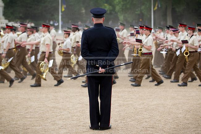 10/06/2013. London, UK. Garrison Sargent Major (GSM) William 'Billy' Mott watches over the Massed Bands of the British Army's Household Division as they carry out a dress rehearsal ahead of the annual Beating Retreat ceremony in London today (10/06/2013). The musical event, which takes place on Horse Guards Parade, will be held on the 12th and 13th of June this year, with Prince Philip and the Queen attending. Photo credit: Matt Cetti-Roberts.