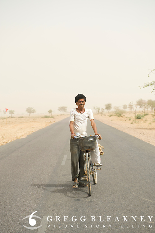 Day laborer commuting in a sandstorm - Rajasthan, India