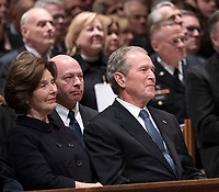 December 5, 2018 - Washington, DC, United States: Laura Bush and George W. Bush attend the state funeral service of former President George W. Bush at the National Cathedral. <br /> CAP/MPI/RS<br /> &copy;RS/MPI/Capital Pictures