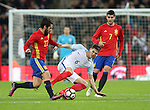 England's John Stones tussles with Spain's Isco during the friendly match at Wembley Stadium, London. Picture date November 15th, 2016 Pic David Klein/Sportimage