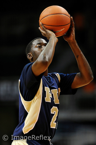 12 December 2008:  FIU's Cedric Essola (21) shoots a free throw in the first half of the Miami 76-50 victory over FIU at the BankUnited Center in Coral Gables, Florida.