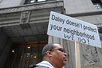"Chicago police officers protest the absence of a working contract for two years, wrapping around city hall with signs that read ""Daley doesn't protect your neighborhood"" and ""end monarchy"" as the International Olympic Committee, IOC, arrived for its final assessment of the city's bid for the 2016 summer games in Chicago, Illinois on April 2, 2009."