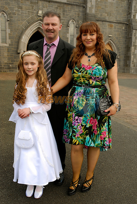 Elisha Heery with her parents David and Angela at the First Holy Communion in Collon on Saturday.
