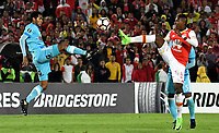 BOGOTA - COLOMBIA – 16 – 03 - 2017: Johan Arango (Der.) jugador de Independiente Santa Fe, disputa el balon con Carlos Lobaton (Izq.) jugador de Sporting Cristal, durante partido entre Independiente Santa Fe de Colombia y Sporting Cristal de Peru, de la fase de grupos, grupo 2, fecha 2 por la Copa Conmebol Libertadores Bridgestone 2017, en el estadio Nemesio Camacho El Campin, de la ciudad de Bogota. / Johan Arango (R) player of Independiente Santa Fe, fights for the ball with Carlos Lobaton (L) player of Sporting Cristal, during a match between Independiente Santa Fe of Colombia and Sporting Cristal of Peru, of the group stage, group 2 of the date 2, for the Conmebol Copa Libertadores Bridgestone 2017 at the Nemesio Camacho El Campin in Bogota city. VizzorImage / Luis Ramirez / Staff.