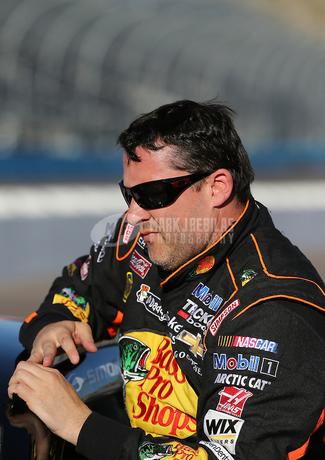 Mar. 1, 2013; Avondale, AZ, USA; NASCAR Sprint Cup Series driver Tony Stewart during qualifying for the Subway Fresh Fit 500 at Phoenix International Raceway. Mandatory Credit: Mark J. Rebilas-