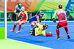 Sakiyo Asano #1 of Japan makes the save from a USA penalty corner while Jill Witmer #10 of United States and Julia Reinprecht #12 of United States look for a rebound during USA vs Japan in a Pool B game at the Rio 2016 Olympics at the Olympic Hockey Centre in Rio de Janeiro, Brazil.