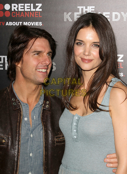 "TOM CRUISE & KATIE HOLMES .""The Kennedys"" World Premiere Held At The AMPAS Samuel Goldwyn Theater, Beverly Hills, California, USA, .28th March 2011..half length blue shirt green dress buttons knitted brown leather jacket couple husband wife married  vest sleeveless s gold letter initial necklace tall short .CAP/ADM/KB.©Kevan Brooks/AdMedia/Capital Pictures."
