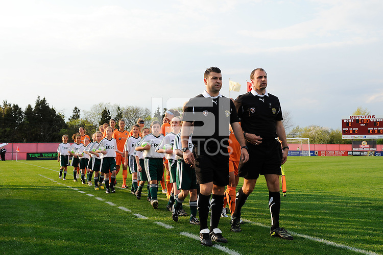 Referees lead Sky Blue FC onto the field. Sky Blue FC defeated the Chicago Red Stars 1-0 in a Women's Professional Soccer (WPS) match at Yurcak Field in Piscataway, NJ, on April 11, 2010.
