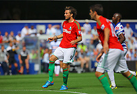 FAO SPORTS PICTURE DESK<br /> Pictured: Michu of Swansea having just scored his opening goal. Saturday 18 August 2012<br /> Re: Barclay's Premier League, Queens Park Rangers v Swansea City FC at Loftus Road Stadium, London, UK.