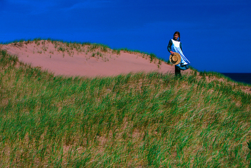 "Young girl portraying ""Anne of Green Gables,"" dunes near Park Corner, Prince Edward Island, Canada"